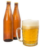Two bottles of beer and a full beer mug Stock Photos