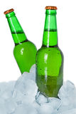 Two bottles of beer on ice Royalty Free Stock Photography