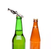 Two bottles of beer and a opener 库存图片