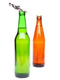 Two bottles of beer and a opener. On the white background Royalty Free Stock Photo