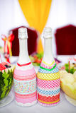 Two bottles of champagne on the table bright Royalty Free Stock Photo