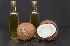 Two bottles of coconut oil isolated on black. Royalty Free Stock Images