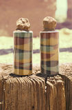 Two bottles of colored sand Stock Images