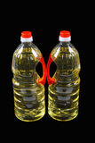 Two bottles of cooking oil Stock Photography