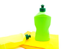 Two bottles of detergent and rags on white Stock Photo