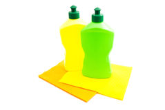 Two bottles of detergent and two rags Stock Image