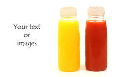Two bottles of fresh fruit juice. Two bottles of fresh red and yellow fruit juice with room for your text or images stock photos