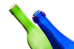 Two bottles in front of a white background. This picture shows two bottles, green and blue, in front of a white background Royalty Free Stock Images