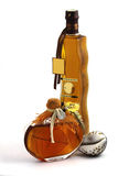Two bottles with fruit liqueur Royalty Free Stock Photos