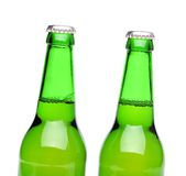 Two bottles of light ale on white background. Stock Photos