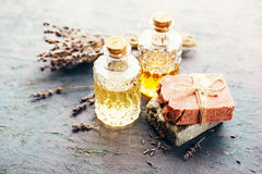 Two bottles of massage oil and different soap dry lavender royalty free stock photo