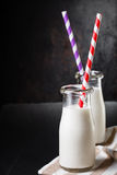 Two bottles with milk stock photography