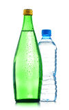 Two bottles of mineral water isolated on white Stock Photos