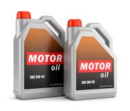 Two bottles of motor oil. Two plastic canisters of motor oil with label isolated on white background Royalty Free Stock Photos