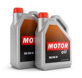 Two bottles of motor oil Stock Images