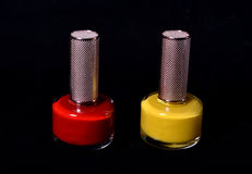 Two Bottles of nail polish on black background Royalty Free Stock Photos