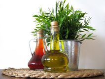 Two bottles of oil stock photos