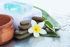 Two bottles with oil for massage. Spa concept with flowers. And leaves stock photography