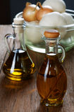 Two bottles of olive oil on table Royalty Free Stock Photo