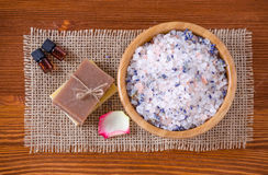 Two Bottles with organic essential aroma oil with rose lavender soap, salt on old wooden background Stock Photo
