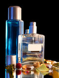 Two Bottles of Parfume - decor. Isolated on black background Royalty Free Stock Image