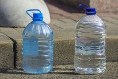 Two bottles with pure drinking water.  Royalty Free Stock Image