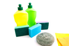 Two bottles, rags and different sponges Royalty Free Stock Image