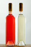 Two bottles of red and white wine without labels Royalty Free Stock Photo