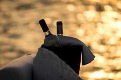 Two bottles of red and white wine on summer stock images