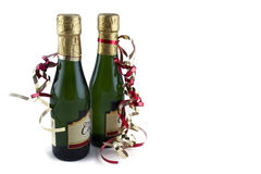 Two bottles of sparkling wine. Isolated image Royalty Free Stock Photo
