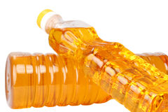Two bottles with vegetable oil. Plastic bottle with vegetable oil on a white background Stock Image