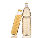 Two bottles of vinegar. Isolated on a white background Stock Photography