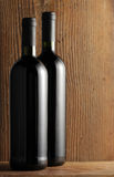 Two bottles of white wine on wooden background Stock Images