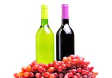 Two bottles of wine and the red grape isolated Stock Image