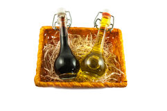 Two bottles of wine vinegar and olive oil in a gift box Royalty Free Stock Photos
