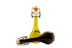 Two bottles of wine vinegar and olive oil Royalty Free Stock Photos