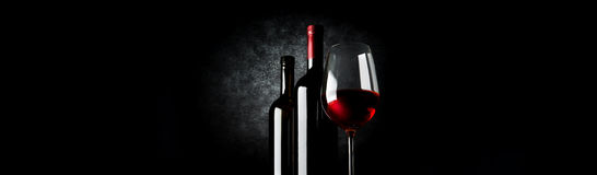 Two bottles and wineglass Stock Image
