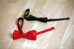 Two bow tie. Red and black Royalty Free Stock Images