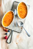 Two Bowl Crema Catalana, Utensils on Side Royalty Free Stock Photography