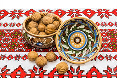 Two bowl and nuts on the tablecloth Stock Photo