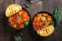 Two bowl of soup minestrone with seasonal vegetables. Italian fo. Two bowl of soup minestrone with seasonal vegetables on wooden table close up, top view Stock Photo