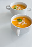 Two bowls of carrot soup Royalty Free Stock Photos