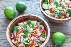 Two bowls of chicken noodle stir-fry. On the wooden table Royalty Free Stock Images