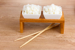 Two bowls of cooked rice and chopsticks Royalty Free Stock Photography