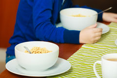 Two bowls with corn flakes breakfast meal at the table Royalty Free Stock Images