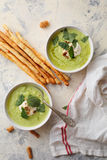 Two bowls of cream soup and bread sticks Royalty Free Stock Photography