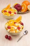 Two bowls with fruit salad on wooden table Royalty Free Stock Photography