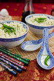 Two bowls with hot asian noodles Stock Image