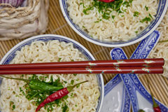 Two bowls with hot asian noodles Royalty Free Stock Images
