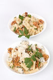 Two Bowls of Pasta with blue cheese and walnuts. Two Bowls of Tube Pasta with blue cheese, Creamy sauce, Walnuts and Fresh Parsley Close up Royalty Free Stock Images